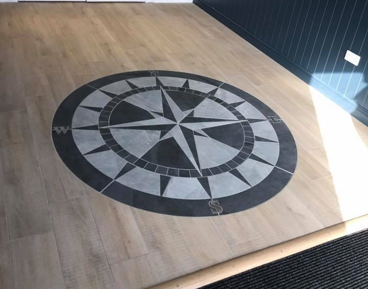 Ceramic tiled compass